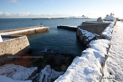 Snowy Colliemore (Dave G Kelly) Tags: ireland winter sea dublin house snow cold wall canon island pier harbour sunny nopeople dalkey sunflare martellotower dalkeyharbour davegkelly colliemore copyright2010davegkelly colliemoreharbour