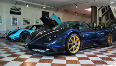 Tricolore. (Alex Penfold) Tags: camera blue cars alex sports car canon photography gold photo cool factory shot image turquoise awesome picture fast super exotic photograph uno showroom rims supercar exotica zonda 2010 supercars pagani penfold tricolore 450d hpyer
