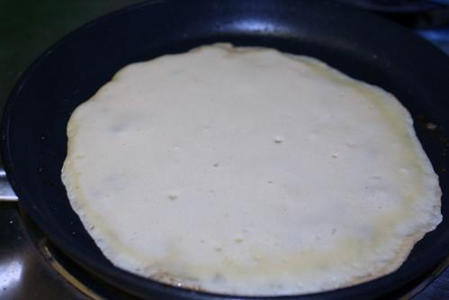 Crepe cooking in pan