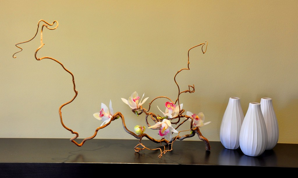 A statement piece of twisty willow and cymbidium orchids.