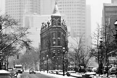 The Gooderham Flatiron Building in Toronto, Ontario (Christopher Brian's Photography) Tags: trees winter blackandwhite bw snow toronto ontario canada cold cityscape flatironbuilding frontstreet thegooderhambuilding sigma7020028ex canoneos7d 49wellingtonstreeteast
