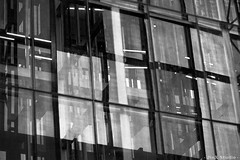 20100612 - Singapore - Orchard Central (Jeremy Tan, KL) Tags: blackandwhite bw abstract reflection window glass lines mono singapore pattern elevator frame duotone geotag orchardcentral jinxstudio