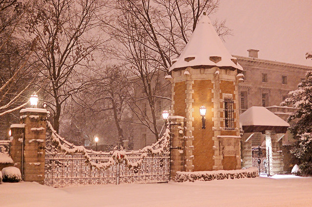 Gate to private street, in Saint Louis, Missouri, USA - view at night with snow