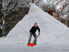 shoveling a mountain of snow