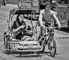 Pedicab TRANSportation (FotoGrazio) Tags: streetportraiture bicycle nikon tranny cheapride people pinoy streetphotography portrait socialdocumentaryphotography philippines documentaryphotography waynesgrazio slowtransportation visayas bacolod contrast transsexual streetportrait waynegrazio fotograzio transportation peddlingabike travelphotography goingtowork texting blackandwhite lifeinthephilippines pedicab