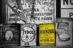 Pennzoil (The Moon & Back) Tags: old cans retro rustic americana rust classic antique feather vignette blackandwhite black yellow pennzoil oil racing nascar selective color light dark shadow sign vintage car hotrod