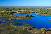 Botswana-070625-078 (Kelly Cheng) Tags: africa travel blue color colour green tourism nature water sunshine horizontal river landscape daylight colorful day outdoor vivid sunny delta bluesky nobody nopeople getty botswana colourful copyspace okavangodelta traveldestinations pickbykc