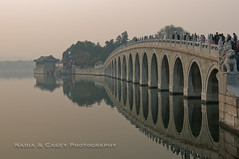 Long Bridge (N+C Photo) Tags: world china city travel bridge trees sunset summer vacation holiday reflection building heritage history water stone architecture asian island photography design casey big nadia asia tour arte pacific action chinese beijing large culture photographers arches palace structure h2o architectural historic east adventure explore architect viajes capitol artists getty civilization ripples traveling fotografia explorers isla mundo cultura travelers structural global gettyimages aventura pekin adventurers expresin historico crouds urbansuburban historyhistoric gettyimagescom gettycollection tripleniceshot mygearandmepremium nadiacaseyphotography cettycollection