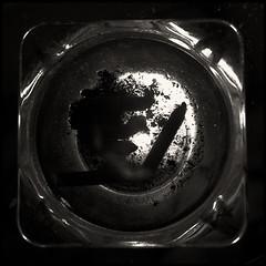 Nicotine (joanpetrus) Tags: light blackandwhite bw white black 6x6 night contrast dark square lumix mono flickr noiretblanc monotone bn panasonic explore squareformat pancake 20mm ashtray schwarzweiss nicotine 43 blancinegre virado 500x500 gf1 pancakelens adiction bwd bwdreams leicalens incoloro monomania artlibre joanpetrus micro43 dmcgf1