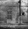E / 04 (OverdeaR [donkey's talking monkey's nodding]) Tags: street door winter bw snow brick texture 120 6x6 film window night facade zeiss rural mediumformat square lights nice rust bars nocturnal tl pavement decay invisible serbia tags compo jena scan textures negative tiny carl scanned ddr roll medium format gutter belgrade nophotoshop pentacon expired six beograd f28 moisture textured hps p6 srbija 80mm orwo c41 nicknames eseries microphen biometar 8028 np22 singidunum autaut 100ei