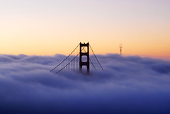 The Land of Fog (AMuljadi) Tags: sf sanfrancisco california ca morning tower fog sunrise dawn nikon purple marin foggy goldengatebridge marincounty d200 breathtaking ggb cokin southtower gnd marinheadland nikond200 cokingnd goldengatebridgetower superaplus aplusphoto nikkor70300mmvr nikkor70300mmf4556gifedafsvrzoom platinumheartaward breathtakinggoldaward breathtakinghalloffame coverupwithfog