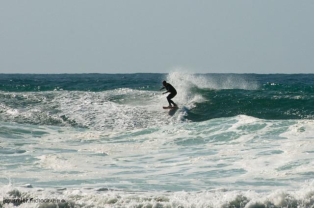 Surf en playa de Vega
