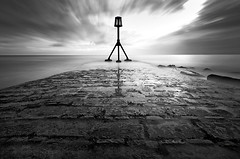 From Beyond (Explored) (simon.anderson) Tags: longexposure sea blackandwhite seascape beach clouds landscape geotagged mono nikon jetty structure explore eastbourne seafront cobbles strut 10mm sigma1020 explored simonanderson 74seconds coastuk mistywater d300s