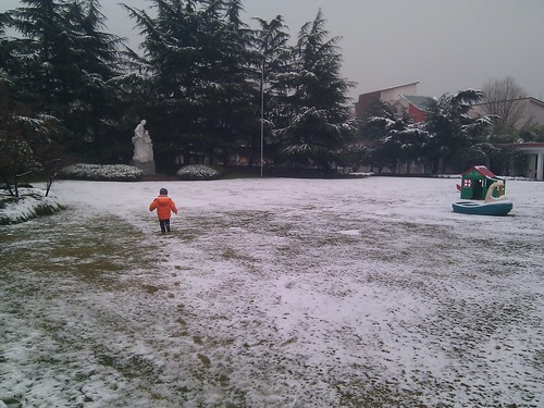 Scott running in the snow at Soong Ching Ling Kindergarten