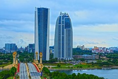 Twin towers  ? (Rajavelu1) Tags: architecture building tower tallbuildings bridge rever green art aroundtheworld artland creative canon6d canonef70200f4llens travel toor putrajaya malaysia simplysuperb city cityscape