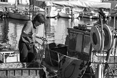 Preparation is half the battle (photographe_d) Tags: danielklblinger fisherman blackwhite mono street streetlife seaport boat fish net europe
