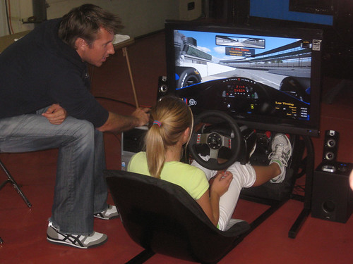 Stephen Simpson gives directions to a young fan on the iRacing simulator