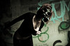 Don't know what she means (nathansmithphoto) Tags: woman girl graffiti model pretty edmonton skin grunge makeup gasmask alive gaia fatale grungy surviving