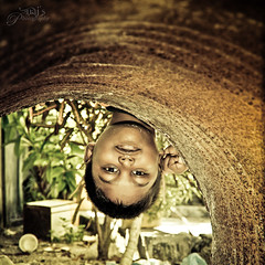 Peek-a-boo! (Naj ( Desired Hopes  )) Tags: portrait love water beauty smile by kids photography kid amazing hilarious backyard missing rust funny gun artist child dancing you bokeh joke great memories young 9 down games dancer 2nd trouble gaming gamer jokes frame lil second click years genius bro miss maldives youngest upside experimenting infront outstanding passionate asks troubling naj maldivian nazy nazih