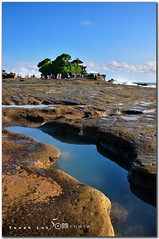 Tanah Lot temple - Bali (fiftymm99) Tags: sunset sea people bali tree nature water stone clouds indonesia temple nikon rocks stones algae d300 tanahlottemple fiftymm fiftymm99 gettyimagessingaporeq2