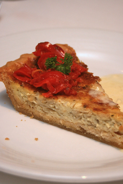 Vidalia Onion Tart: sweet Vidalia onions combined with nutty Gruyère cheese, baked in a buttery crust, served with leek fondue and sauteed red peppers