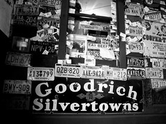 license plate wall (frankieleon) Tags: blackandwhite bw signs wall businesscards goodrich licenseplates silvertowns junkwall frankieleon