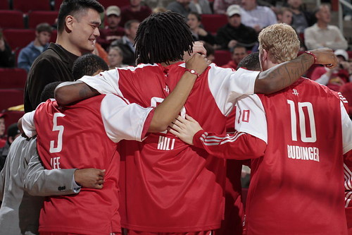 December 27th, 2010 - Yao Ming joins his teammates in a pre-game huddle