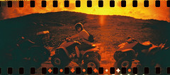 ATVing (narwhalicious) Tags: film 35mm lomography panoramic aruba redscale sprocketrocket