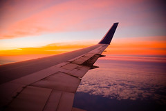 We need only travel enough to give our intellects an airing. (kevkev44) Tags: trip sunset sky window clouds airplane flying high airport wings aircraft cockpit delta pacificocean airline boeing guam 747 767 747400 longride 30000feet 30000 deltaairlines inthesky maybetoomuchprocessingugh