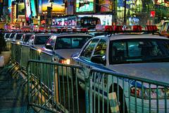 New York's Finest (Gary Burke.) Tags: nyc newyorkcity ny newyork car night canon buildings eos rebel lights neon manhattan broadway police nypd landmark icon midtown timessquare cop policecar gothamist dslr barricades barricade theaterdistrict garyburke klingon65 t1i canoneosrebelt1i