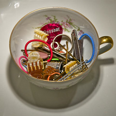 Cup of Chaos (LaValle PDX) Tags: shadow chaos thimble teacup rubberbands hairbands safetypin limoges hairclips bobbypins guitarpick goldrim ourdailychallenge