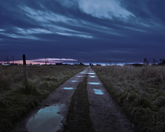dismal. (Guy Catling) Tags: sea sky moon grass rain clouds dark stars puddle boats photography boat nikon dismal path stones walkway marsh moor puddles edit lightroom marshes catters greay catterz d3000 piiiiiissssss