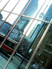 a city reflected (Ian Muttoo) Tags: toronto ontario canada reflection reflections cntower ttc gimp streetcar torontotransitcommission roythomsonhall sunlifecentre dsc2839edit