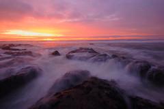 Submersion (Don Jensen) Tags: longexposure sunset sun beach clouds washington waves 4 olympic peninsula