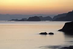 Layered (Stuart Stevenson) Tags: longexposure sea water dawn glow tide earlymorning rocky cliffs northernireland countyantrim ballintoy northatlanticocean carrickarederopebridge northantrimcoast canon70300mm thanksforviewing canon5dmkii carrickaredeisland stuartstevenson