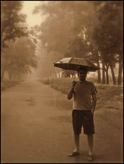 MONSOON WALK (manumint-[BUSY]) Tags: road trees summer plants india green nature sepia umbrella town walk happiness relief nostalgia soil monsoon cousin punjab rains morningwalk rainseason talwara iloverainyday