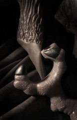 Caliper Touch (Sea Moon) Tags: stilllife toy soft hard surreal rubber plastic textures claw latex grip wrinkles puckered
