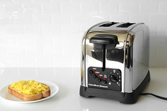 Toaster next to with bread with egg on it (yourbestdigs) Tags: toaster bread toast chrome steel appliance breakfast household technology equipment home background food metal isolated electric kitchen white new utensil modern object metallic aluminum stainless machine domestic kitchenware egg