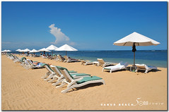sanur beach bali (fiftymm99) Tags: travel blue sea bali holiday seascape beach clouds umbrella bench indonesia landscape nikon asia tourists suntan sands spa sanur sku d300 fiftymm99 gettyimagessingaporeq2