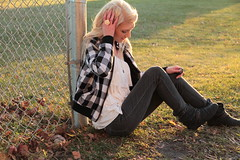 outtake/unedited/tagged :) (Shandi-lee) Tags: november autumn sun selfportrait girl grass leaves fence alone sitting boots wind naturallight ground tagged jeans blonde plaid blondehair schoolyard ruffleshirt sooc plasticrosering tenfacts shandilee