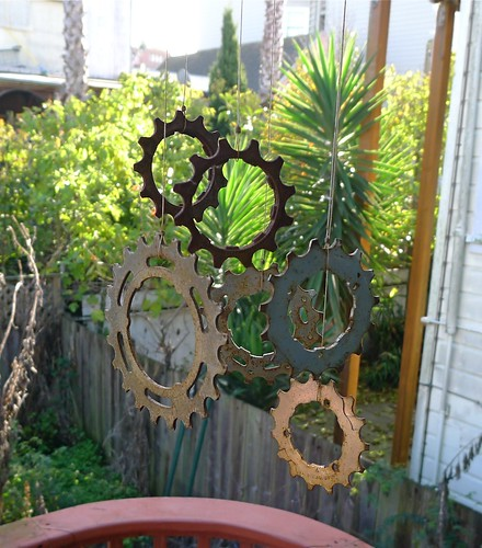 Bicycle cog wind chimes with rusty patina