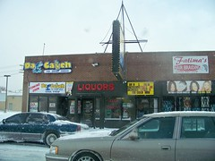 Da Catch, Liquors, Fatima's (sheriffdan10) Tags: street fish signs building brick cars sign hair marquee restaurant store broadway indiana gary liquors tobacco fatima braiding hairbraiding dacatch