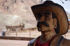 A big wide world (4 of 7).jpg (Bring Back Words) Tags: portrait west face statue shop wagon store cowboy calico western ghosttown mustache trinket woodenstatue earing