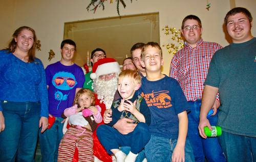 The kids posing with Santa