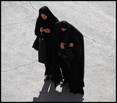 Checking the Pictures (jotemel) Tags: camera two sunlight black composition persian iran muslim islam hijab christian syria chador maloula abigfave