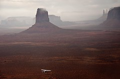 plane at monument3 (maryannenelson) Tags: clouds flying desert monumentvalley