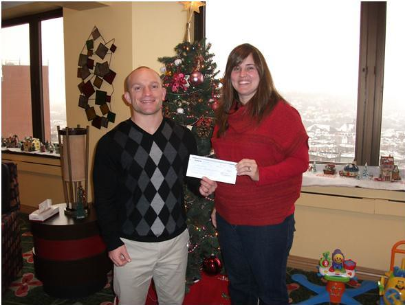 Farmland donates award money for its environmental excellence to Ronald McDonald House Funds