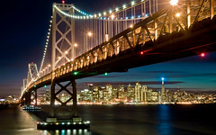 The Bay Bridge (Matt Granz Photography) Tags: baybridge sanfrancisco beacon transamerica embarcadero california night lights bay ocean pacific longexposure architecture skyline skyscrapers reflections yerbabuena island city cityscape sf 2010bb visipix