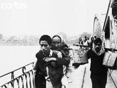 NA002647 (manhhai) Tags: bridge people water river asia southeastasia refugee vietnam civilian fleeing southvietnam historicevent asianhistoricalevent northamericanhistoricalevent unitedstateshistoricalevent vietnamwar19591975 vietnamesehistoricalevent militaryoperation tetoffensive1968