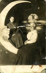 Two Women and Paper Moon with Earth Backdrop RPPC (depthandtime) Tags: old original woman vintage stars star women earth antique postcard novelty backdrop damaged foundphoto papermoon foundimage rppc realphoto